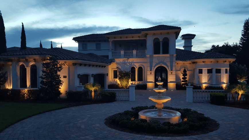 orlando landscape lighting installed on front of home and fountain